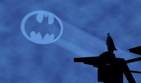 bat signal light holy calls robin williams to team up with batman