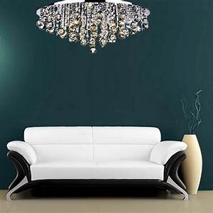 Crystal chandelier close to ceiling light pendant top