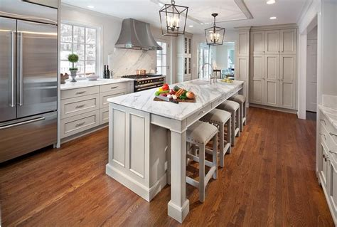 Gray Kitchen Island With Vintage Bar Stools Transitional