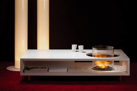 unique coffe table combined with modern round fireplace