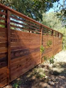 foot custom horizontal fence  slat top stained