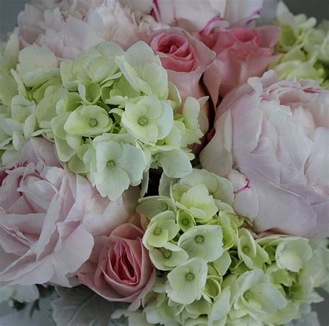 peonies and roses old pink roses white hydrangeas pink peonies in a bridal bouquet for bridesmaids flowers
