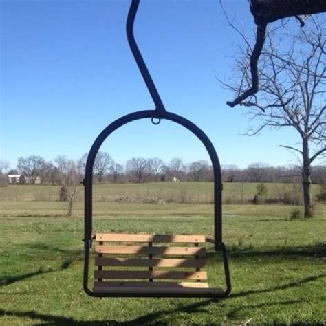 an ski lift chair redone into a tree swing made by