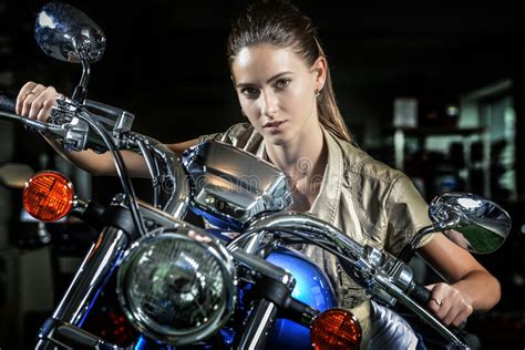 Pretty Woman On Motorcycle At Night Stock Photo