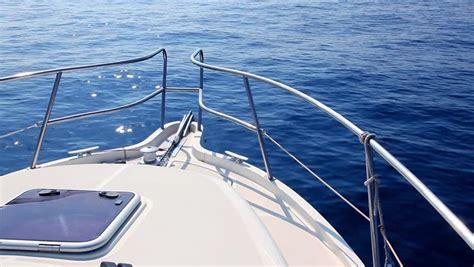 Deck Boat In Ocean boating in blue ocean sea view from boat bow deck stock