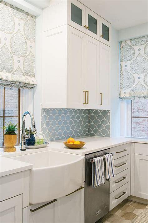 blue kitchen backsplash tiles  white cabinets