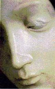 Pieta showing repaired nose, chipped eyelid