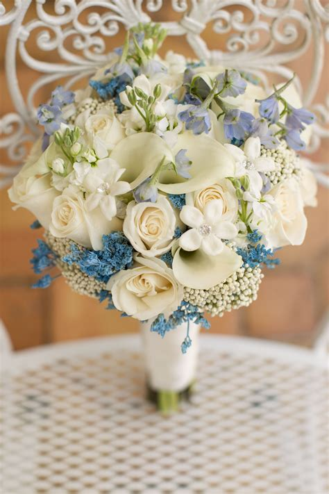 brides ivory white bouquet   touch  blue