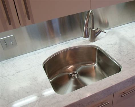 offset faucet    shaped sink