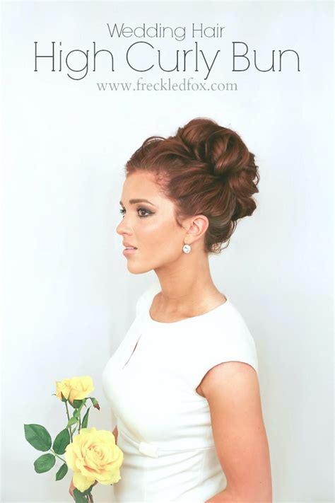 the freckled fox wedding hair week high curly bun by meyers