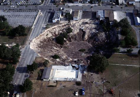 massive sinkhole swallows part  florida house  apopka