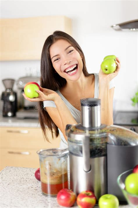 juicer juice apple machine kitchen making woman juicing healthy happy smoothie eating fruit food