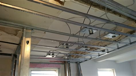 installing  drop ceiling   basement laundry hgtv