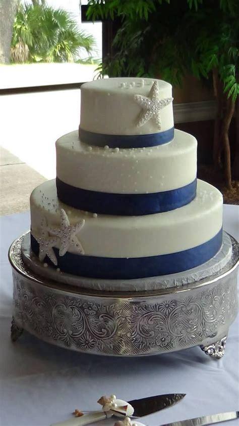 elegant starfish wedding cake  royal blue ribbon