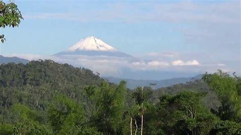 sangay volcano towering   clouds macas ecuador