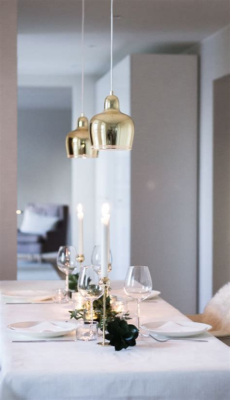 Winter and christmas table decor. Brass, white, green