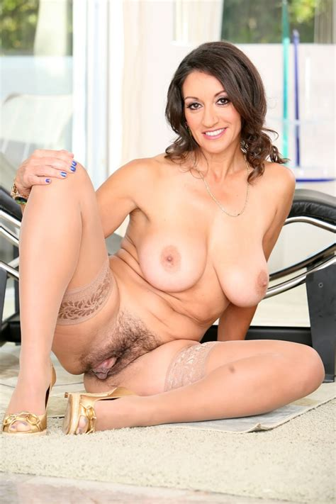 Busty Glamour Cougar In Nylons Shows Her Bush After She Takes Off Her Silk Dress And Panties