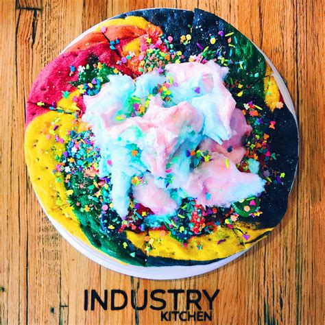 the black unicorn 39 unicorn pizza 39 a rainbow sugar cookie covered with