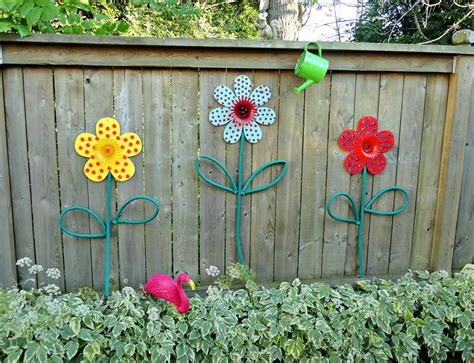 Dollar Store Flowers Turned Into Garden Art With Hoses For