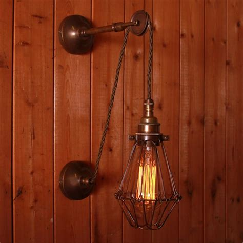 vintage adjustable wall light with pulley and cage
