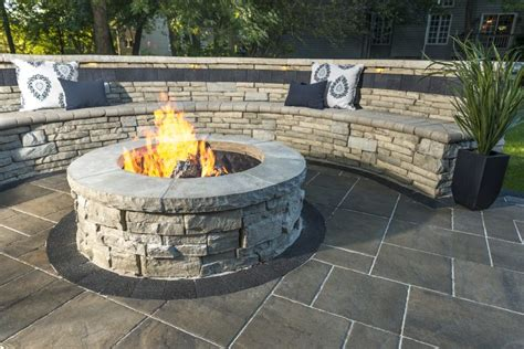 unilock pit patio with a rivercrest pit kit and seating wall photos