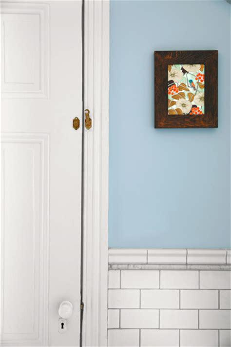 light blue master bath after remodel with white porcelain