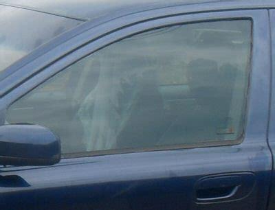 volvo oem left front door window glass  laminated fits