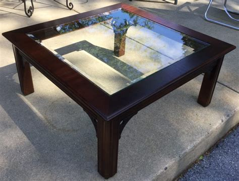 Glass top a good coffee table inspires creativity, comfort, and enjoyment in the space around it. Cherry Wood/Glass Coffee Table - Stock Swap Furniture Consignment