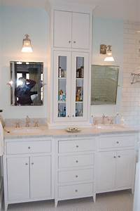 Custom white bathroom vanity with tower by wooden hammer for Bathroom vanities with storage towers