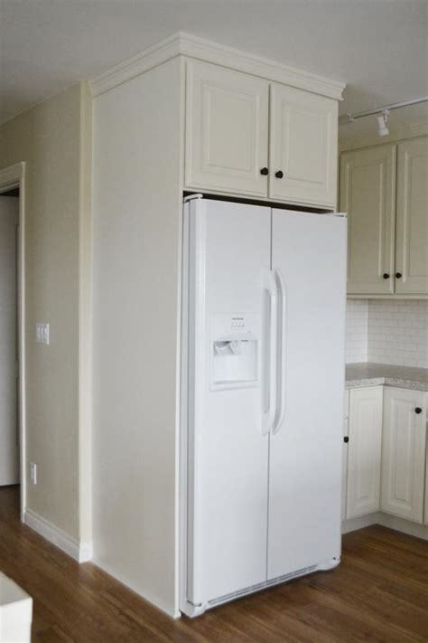 In Cabinet Refrigerator by Boxing In Fridge With Cabinetry Momplex Vanilla Kitchen