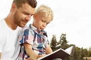 Little boy reading book with dad Stock Photo free download