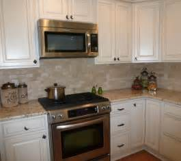 colonial kitchen ideas colonial gold granite and tumbled travertine backsplash