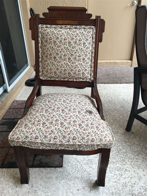 old flower pattern two wheeled wooden chair my antique