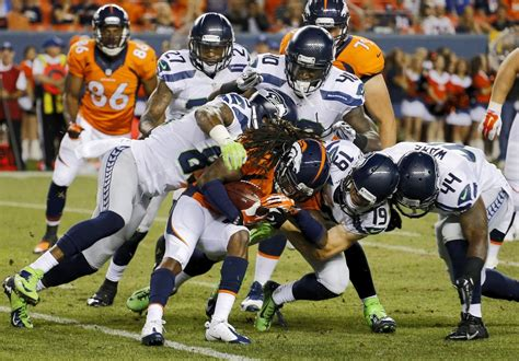seahawks slowed  lightning downpour  flags  loss