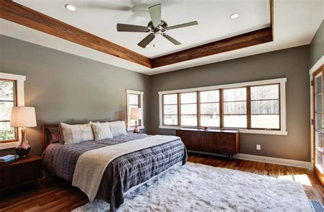 gray tufted light gray walls with wood trim family room transitional