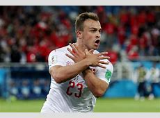 Xherdan Shaqiri and Granit Xhaka celebrate Switzerland