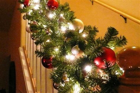 How To Decorate Banister With Garland by Stairway Banister Decorated For