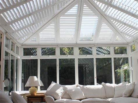 Conservatory roof shutters in white