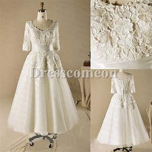 Ball gown plus size tea length with sleeves ivory lace for Plus size wedding dresses with sleeves tea length