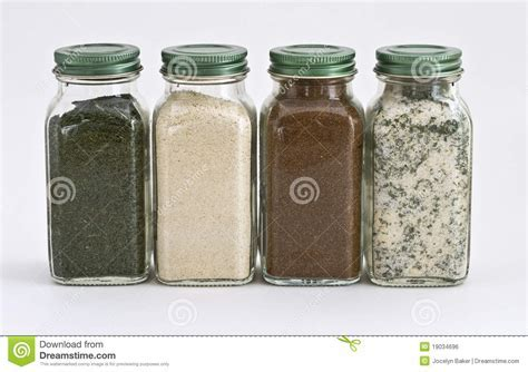 Set Of Four Spices In Glass Jars Stock Photo   Image of