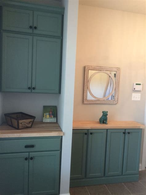 sherwin williams dried thyme painted home depot unfinished oak cabinets in mudroom homes