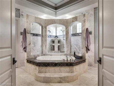 grey marble master bathroom  soaking tub  walk
