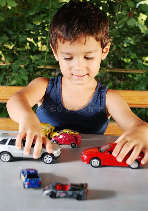 kid play car children playing with cars toys outdoor in summer stock