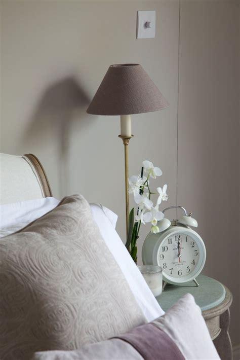 Farrow + Ball Elephants Breath paint in bedroom. Fabrics