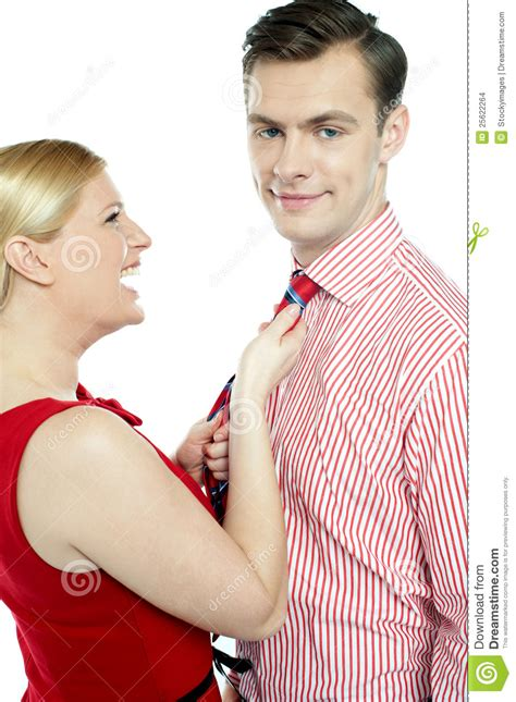 glamorous woman pulling man   tie stock images