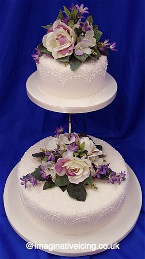 lace piping silk flowers ivory wedding cake