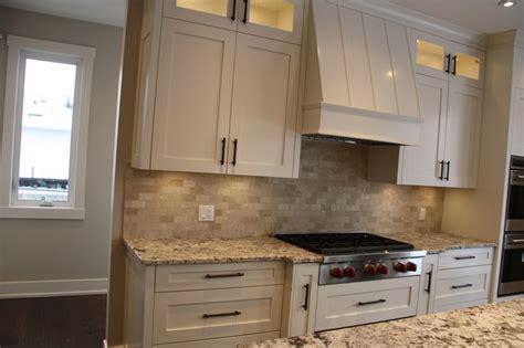 Range In Kitchen Island - custom kitchen cabinets with custom built range hood wolf range top with alaska white granite