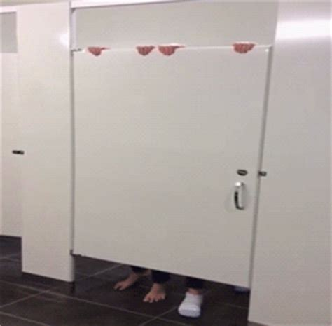 bathroom stall prank gif new trending gif on giphy lol fail ouch door