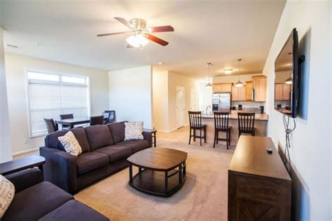 Furnished Corporate Apartments For Weekend Or Extended Stays Fireplace Glass Beads Doors Online Mantel Blueprints Blower Installation Wall Mounted Ethanol Screen Decorative Electric Tv Stand Big Lots Remove Soot From Brick