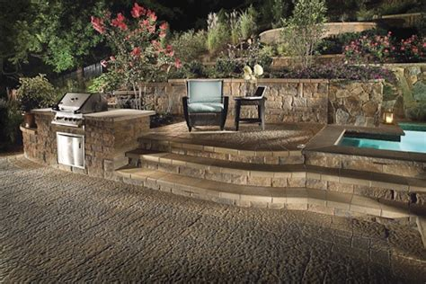 raised patio with bbq and tub the yard